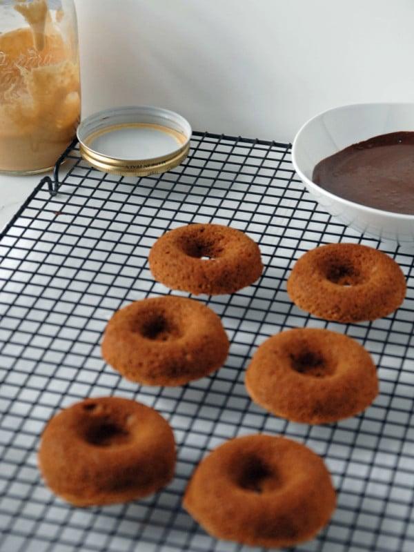 vegan chocolate peanut butter doughnuts on rack
