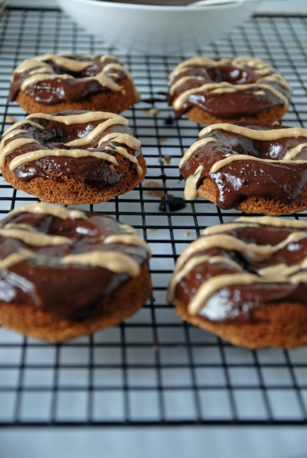 vegan chocolate peanut butter doughnuts with drizzle