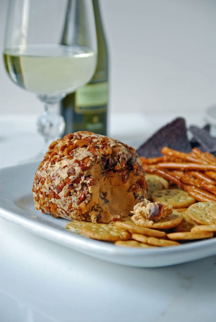 spicy Cheese ball on a plate with crackers