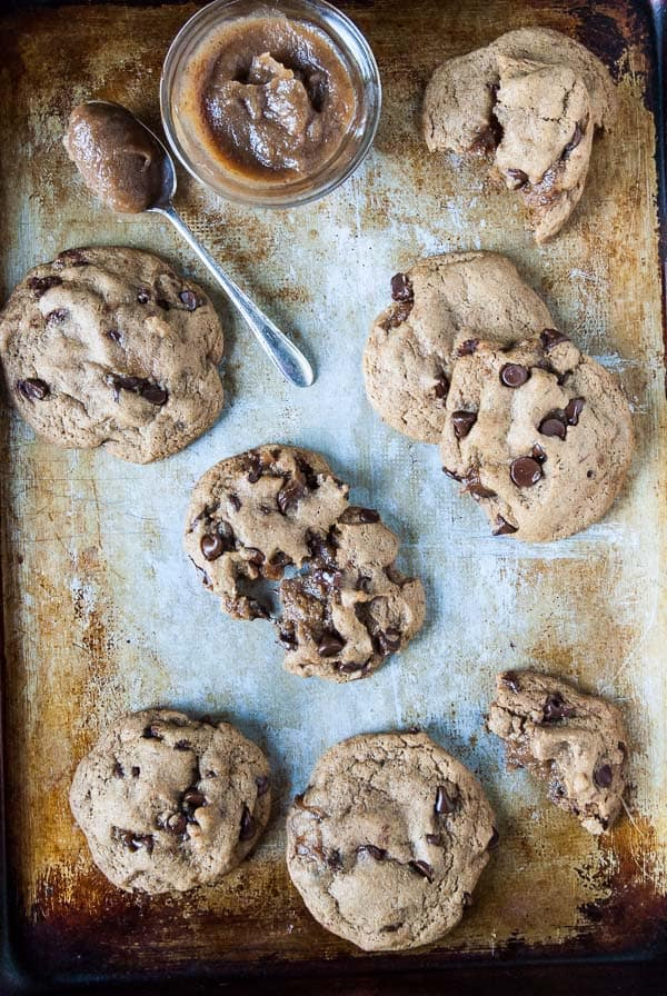 caramel stuffed vegan chocolate chip cookies on baking tray