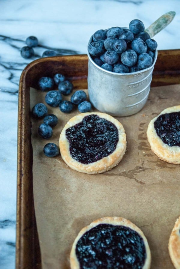 Vegan Blueberry Ginger Danishes - Vegan danishes that are just as good as the original, including the prettiest sweet blueberries and a kick of ginger! Homemade with yeast and berry jam.