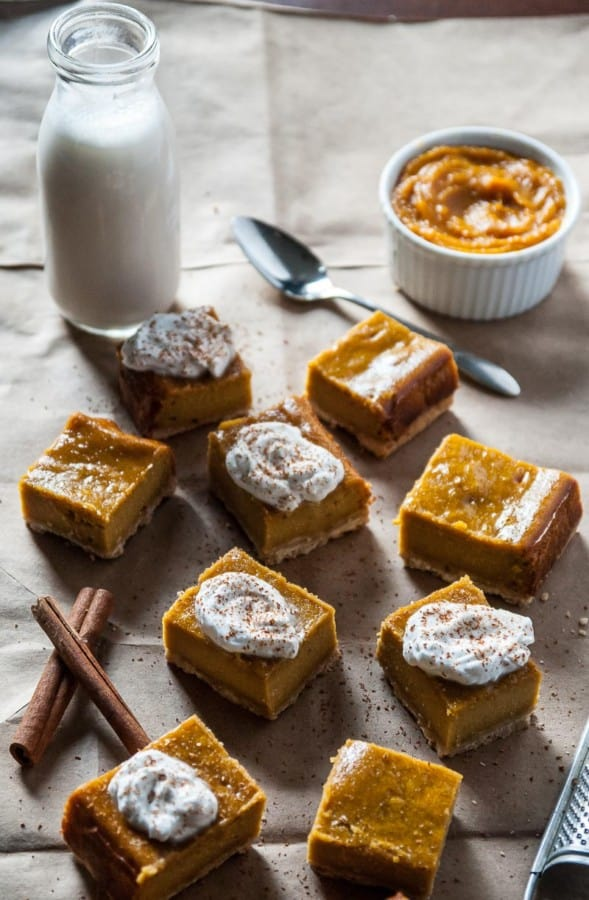 Vegan Pumpkin Cheesecake Bars- Vegan pumpkin cheesecake bars are given a fall twist with pumpkin, spices and a vegan shortbread crust!