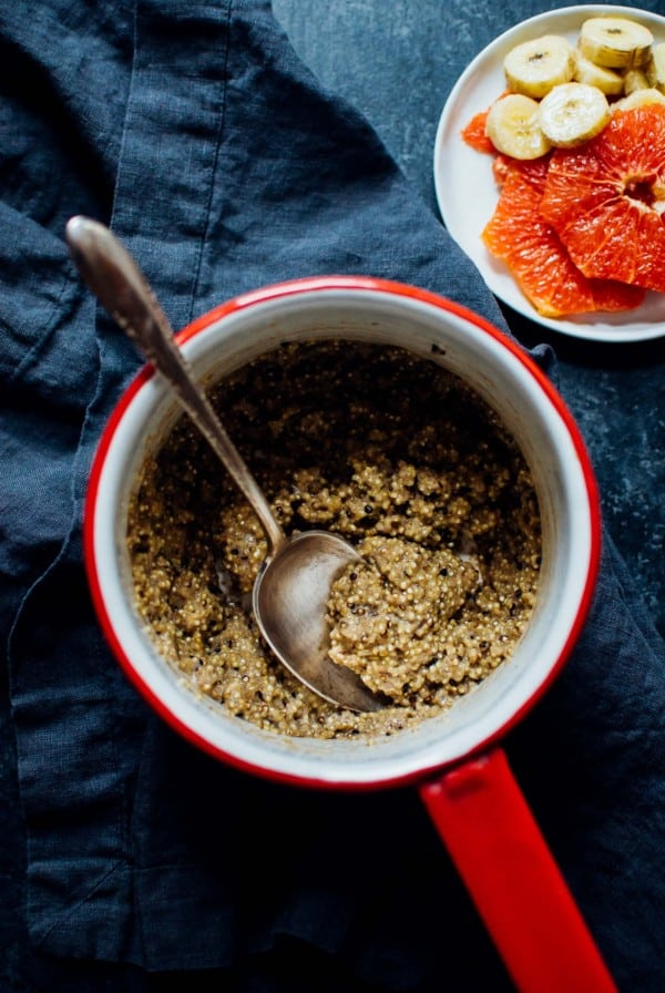 A sweet and creamy breakfast quinoa bowl, topped with oven roasted bananas and grapefruit and topped with cinnamon and almonds!