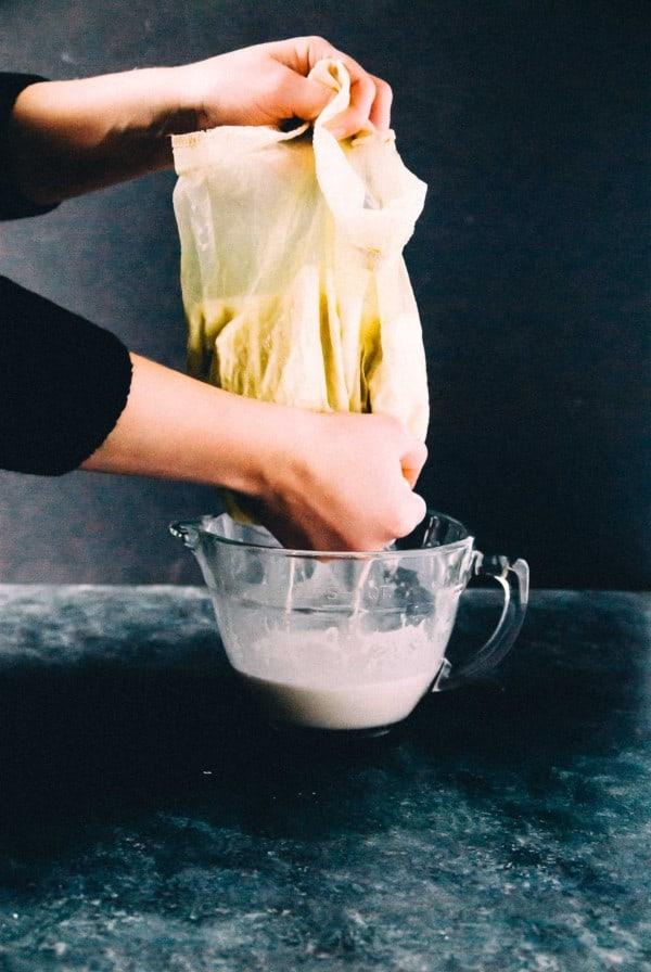 straining homemade cashew milk