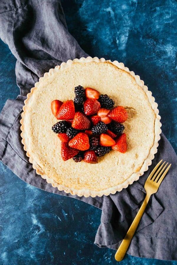 Vegan Lemon Tart with Shortbread Crust- a sweet and easy lemon tart, made right in the blender! Using the easiest shortbread crust and topped with sweet berries.