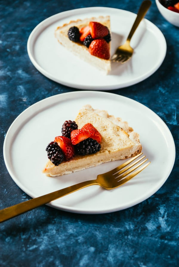 Vegan Lemon Tart with Shortbread Crust- a sweet and easy lemon tart, made right in the blender! Using the easiest shortbread crust and topped with sweet berries.