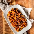 A sweet and savory sweet potato salad with pecans and dried cranberries, perfect for summer cookouts and parties! Made with a sweet balsamic vinaigrette and tart cranberries.