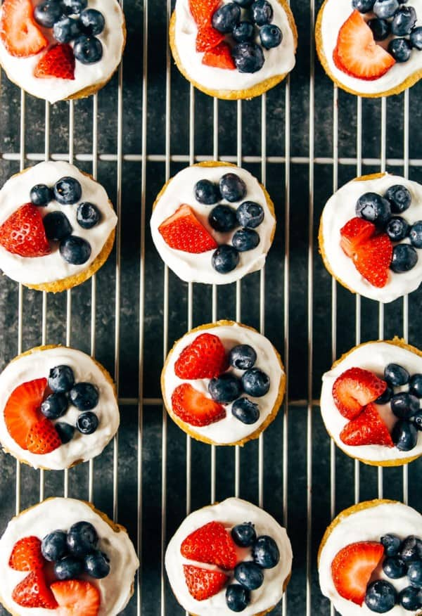 Vegan lemon cakes with a sweet coconut whipped topping and the summer's prettiest berries!