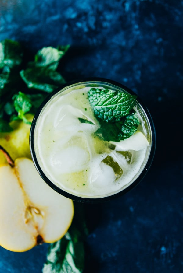 A sweet and refreshing fall drink, this pear bourbon smash has mint, pear, and just a hint of maple syrup!