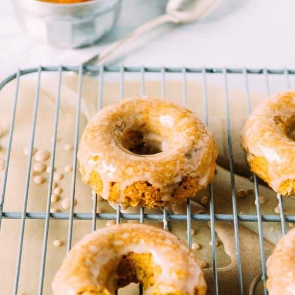 Vegan Pumpkin Doughnuts with Cinnamon Maple Glaze
