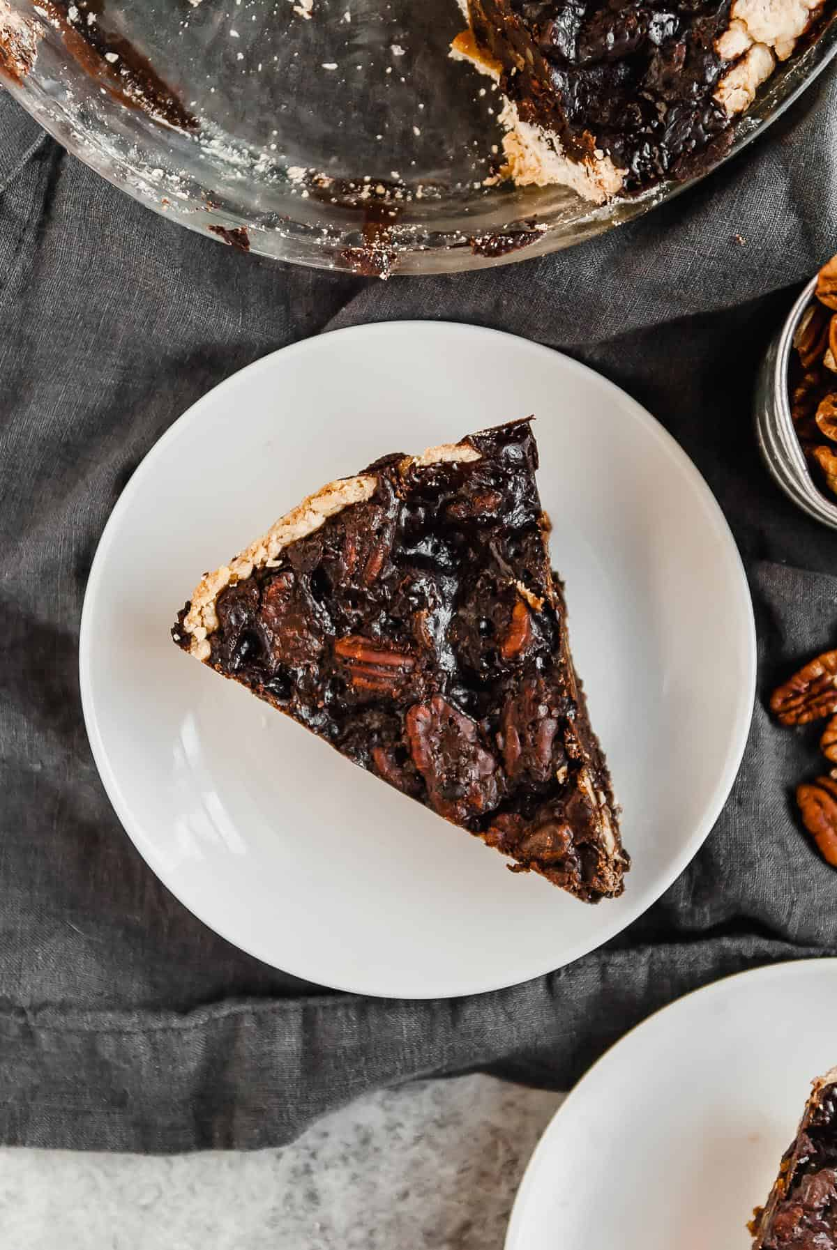 Vegan pecan pie is great, but make it one step better with chocolate! A perfect Thanksgiving or holiday dessert and made with an easy coconut oil crust.