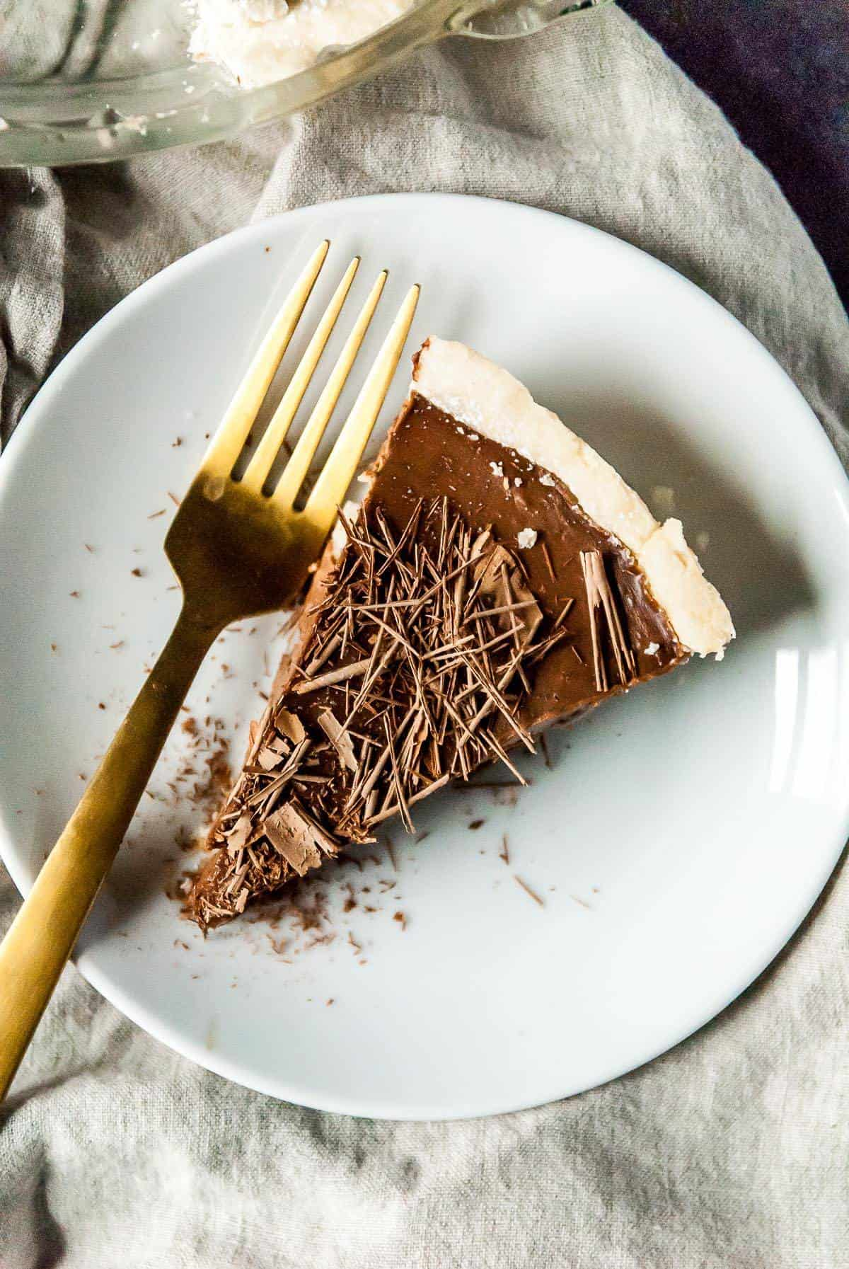 This easy vegan chocolate cream pie is made without tofu and is soy free! Made with coconut milk, a shortbread crust and lots of chocolate.