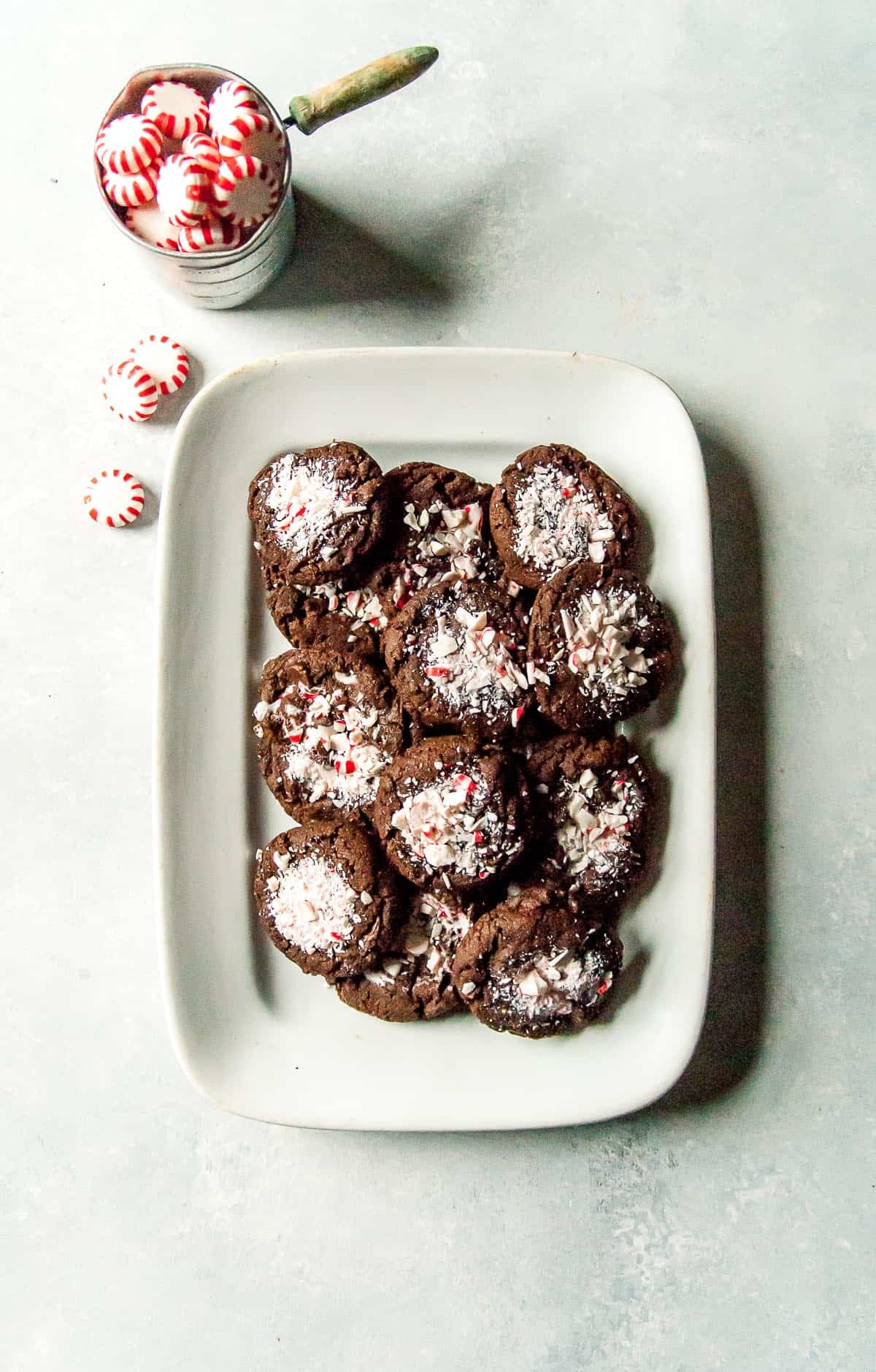 A perfect holiday cookie, vegan chocolate peppermint cookies filled with chocolate chips and crushed peppermints!