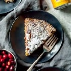 Serve up a slice of fresh cranberry ginger cake! Perfect for your holiday brunch or for your next festive dinner! Made vegan with olive oil and lots of fresh ginger.