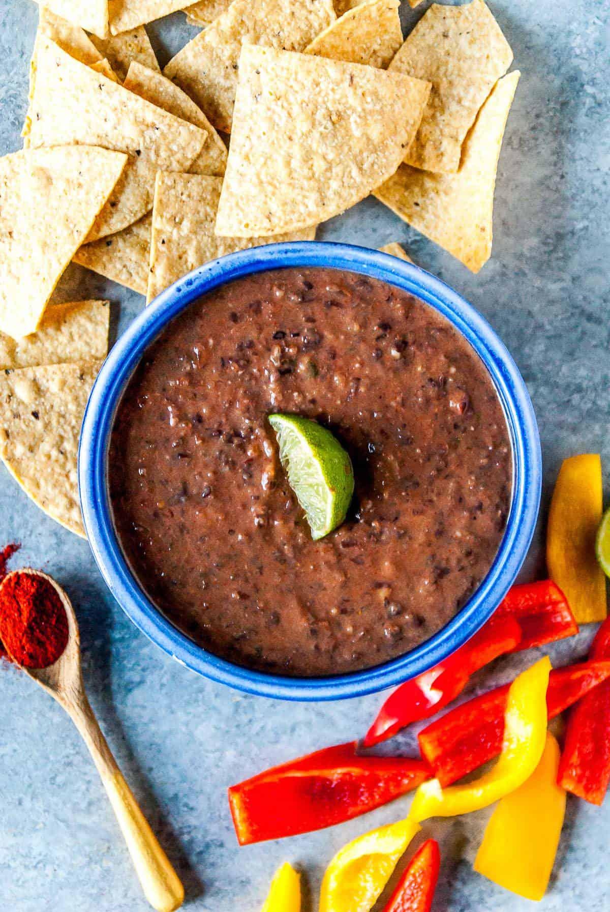 spicy vegan black bean dip with lime wedge on top