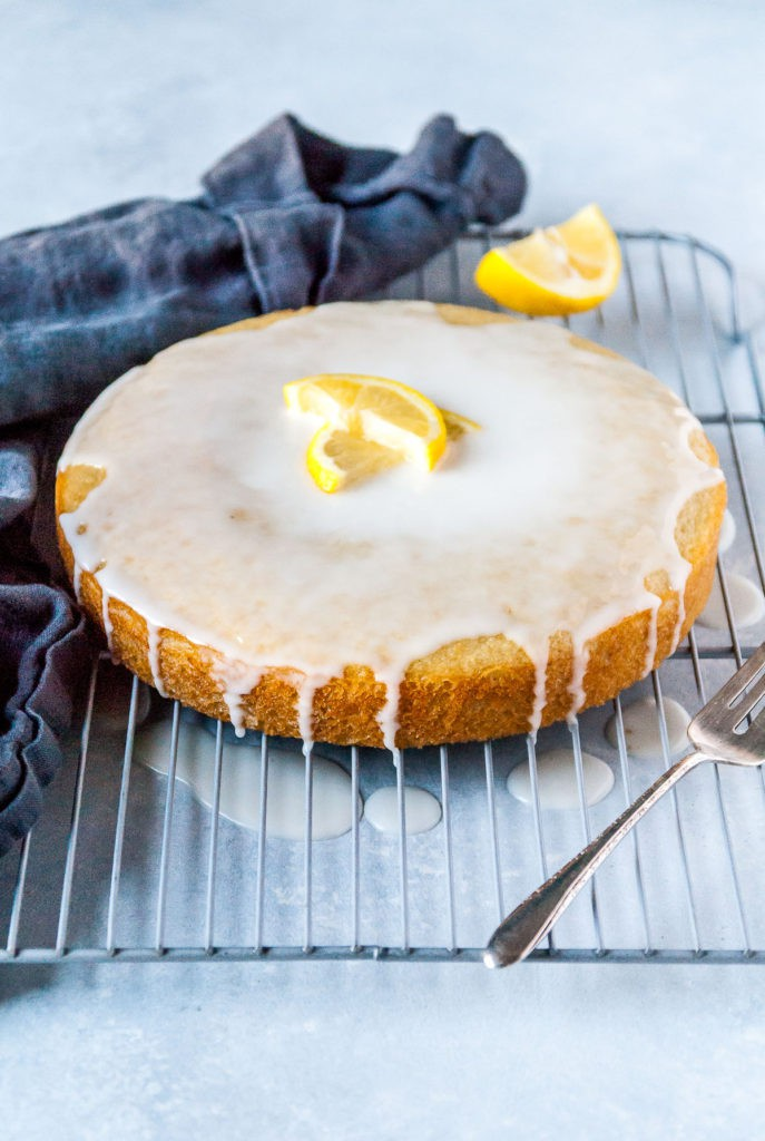 A perfectly sweet and tart vegan lemon olive oil cake! Frosted with a powdered sugar glaze, this cake is bound to be your new favorite lemon dessert.
