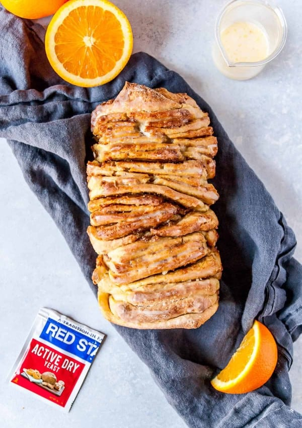 Vegan pull-apart bread that is SO fluffy and perfect, packed with fresh orange flavor and the BEST sweet orange glaze!