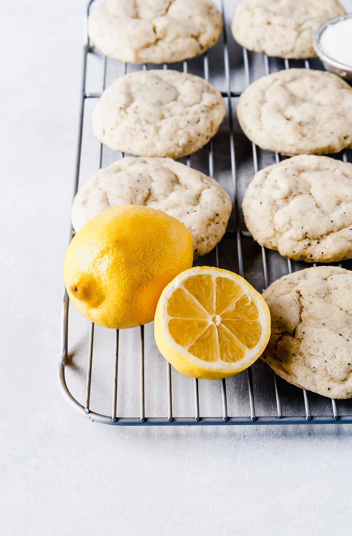 Close up of lemons and citrus poppy seed vegan sugar cookies