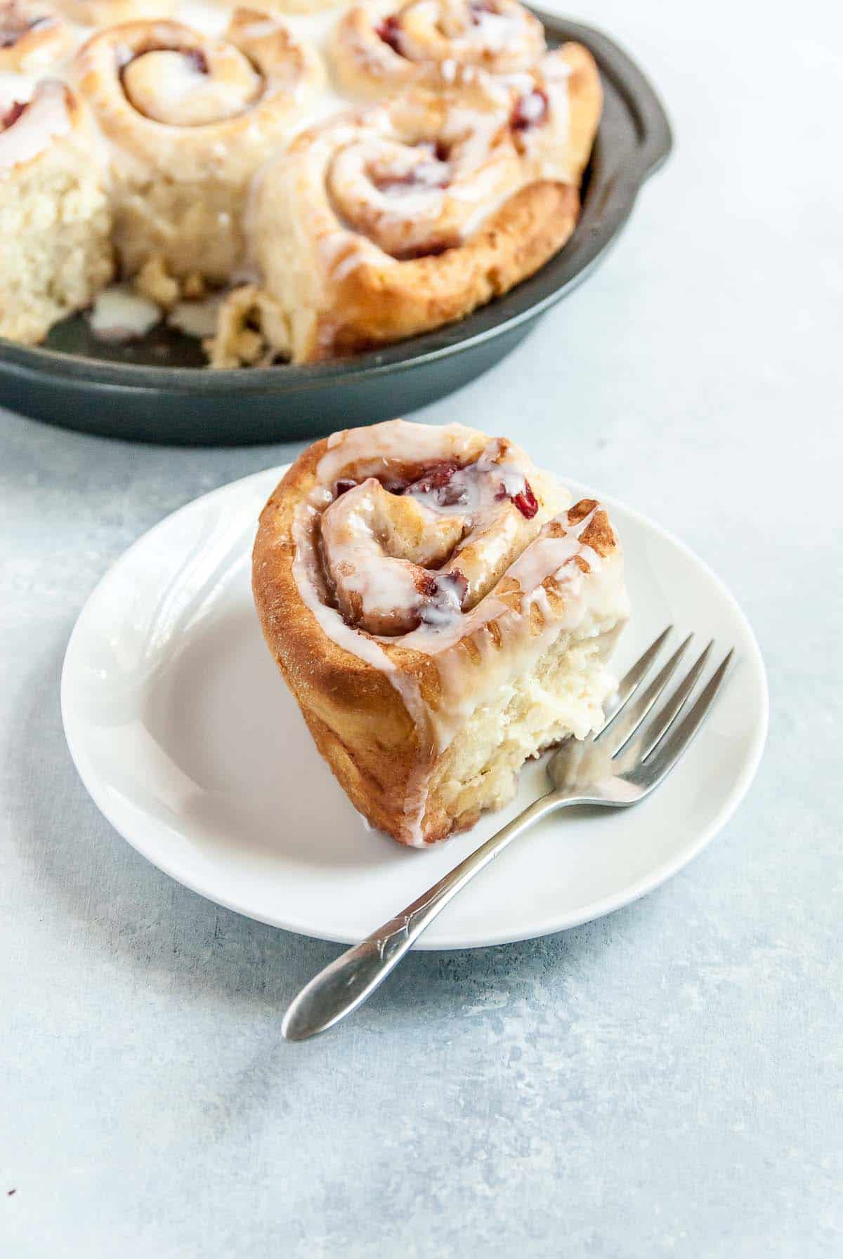 vegan cherry cinnamon roll on plate