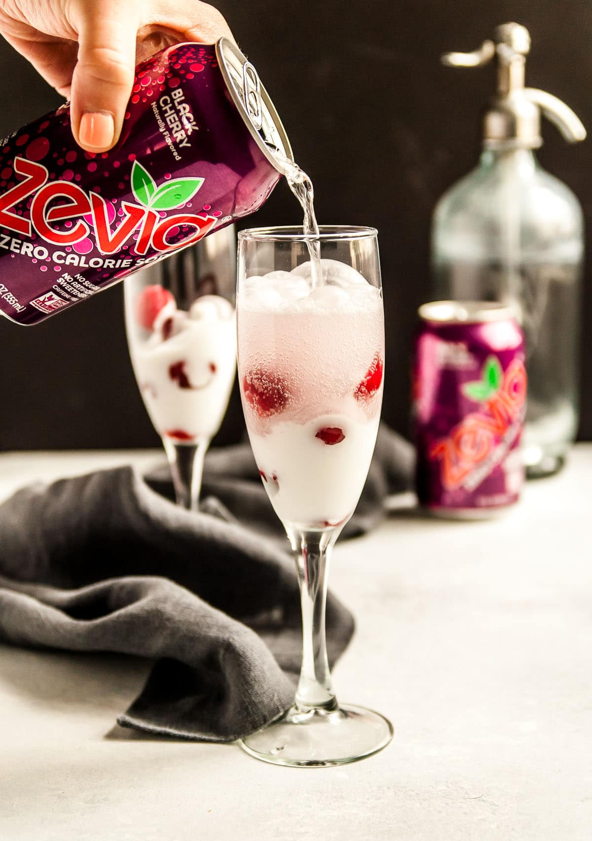 zevia can pouring drink into glass