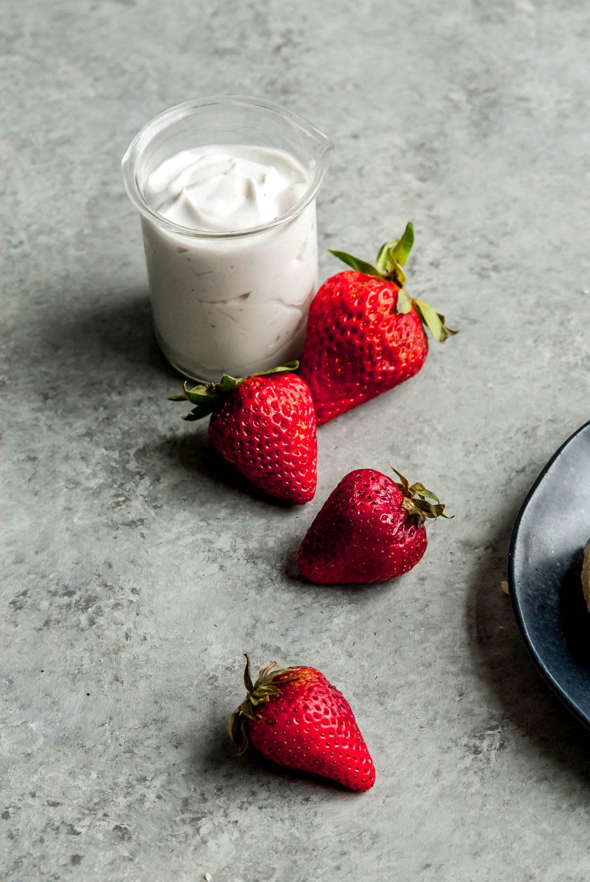 strawberries on a grey background