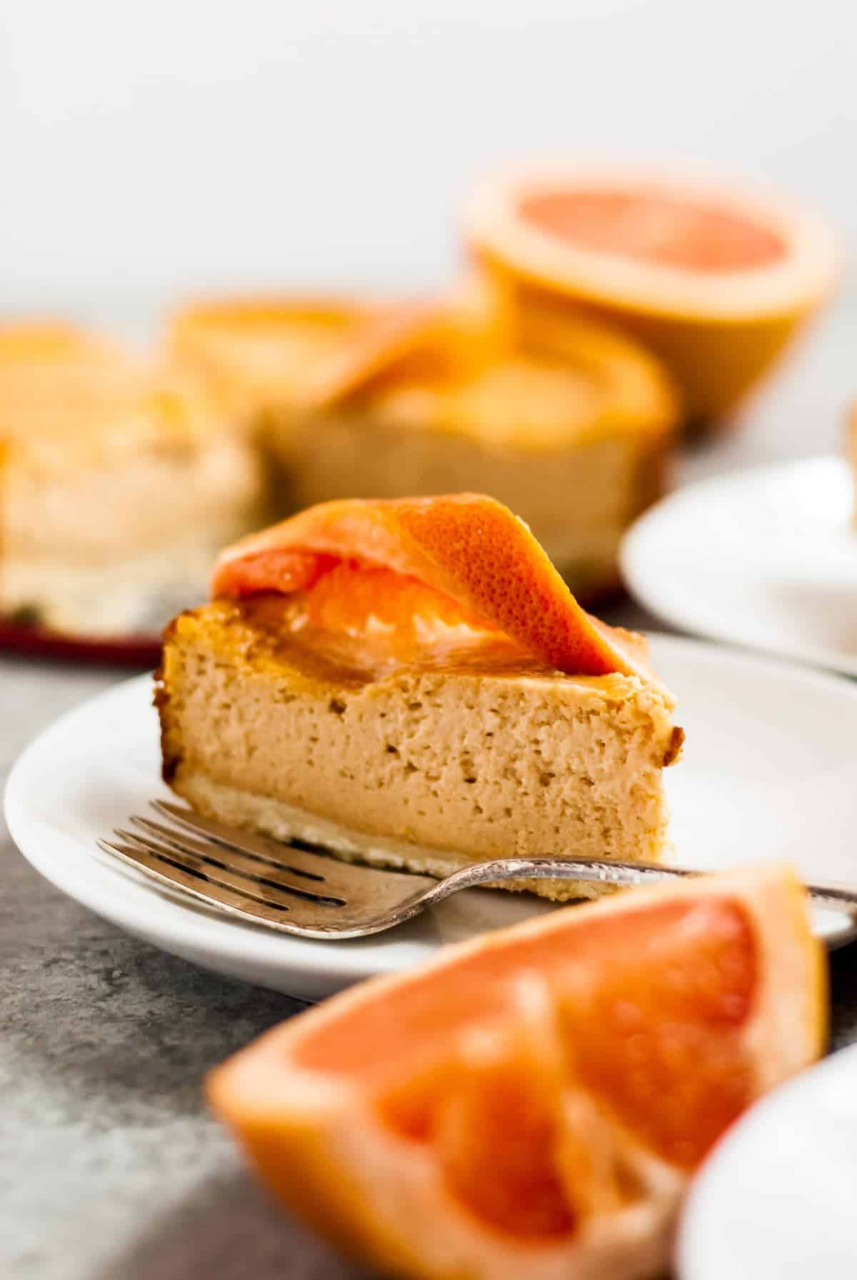 cheesecake on plate with grapefruit