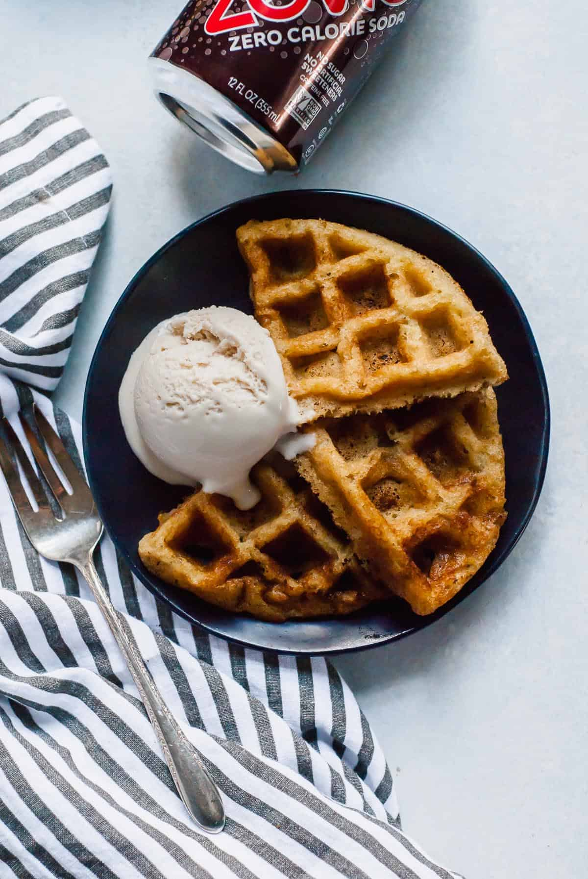 waffles on blue board with zevia can and striped napkin