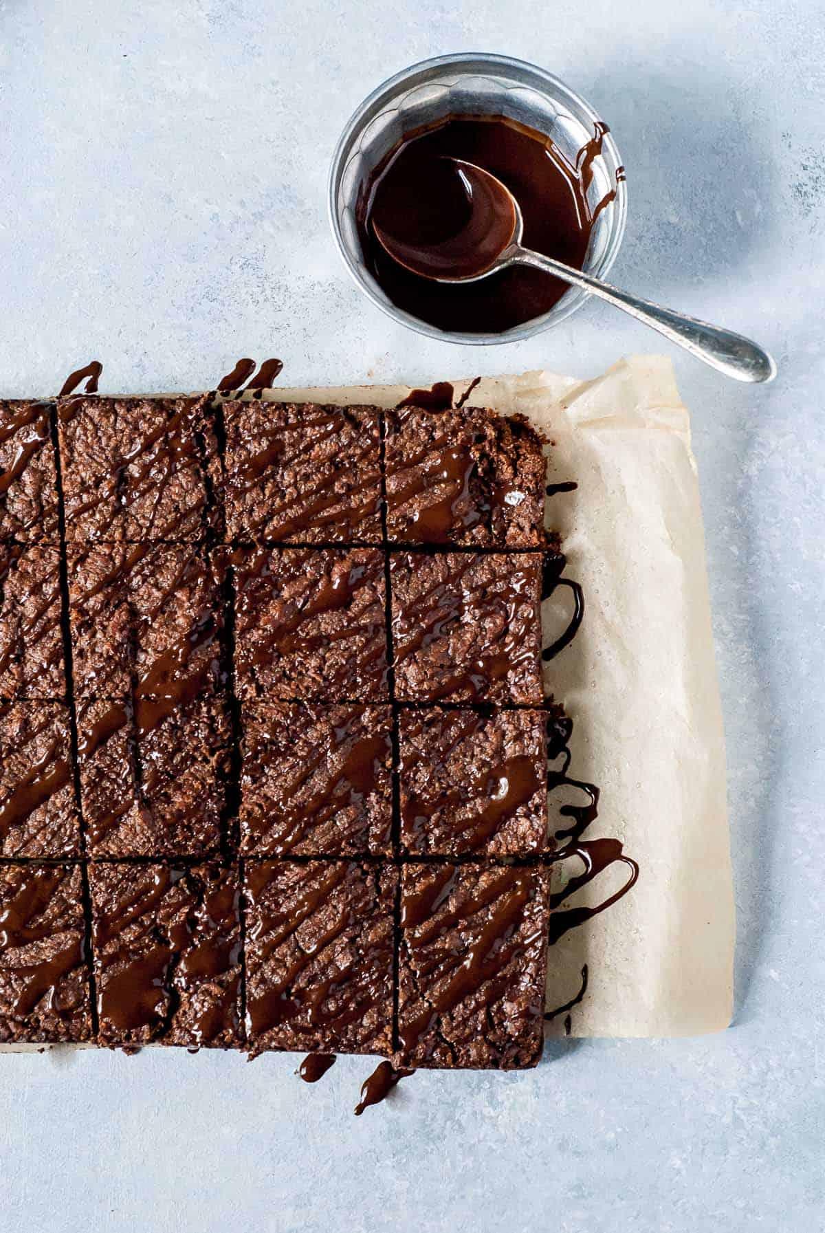 Chocolate shortbread cut into pieces on blue board