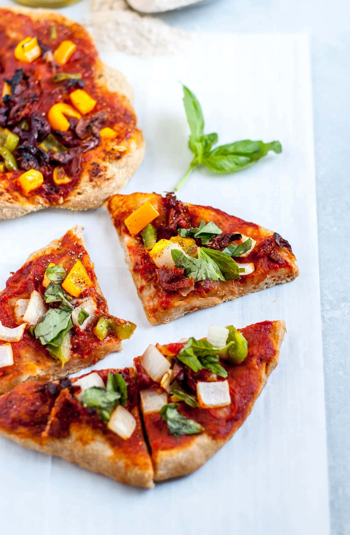 slices of vegan pizza on a blue background