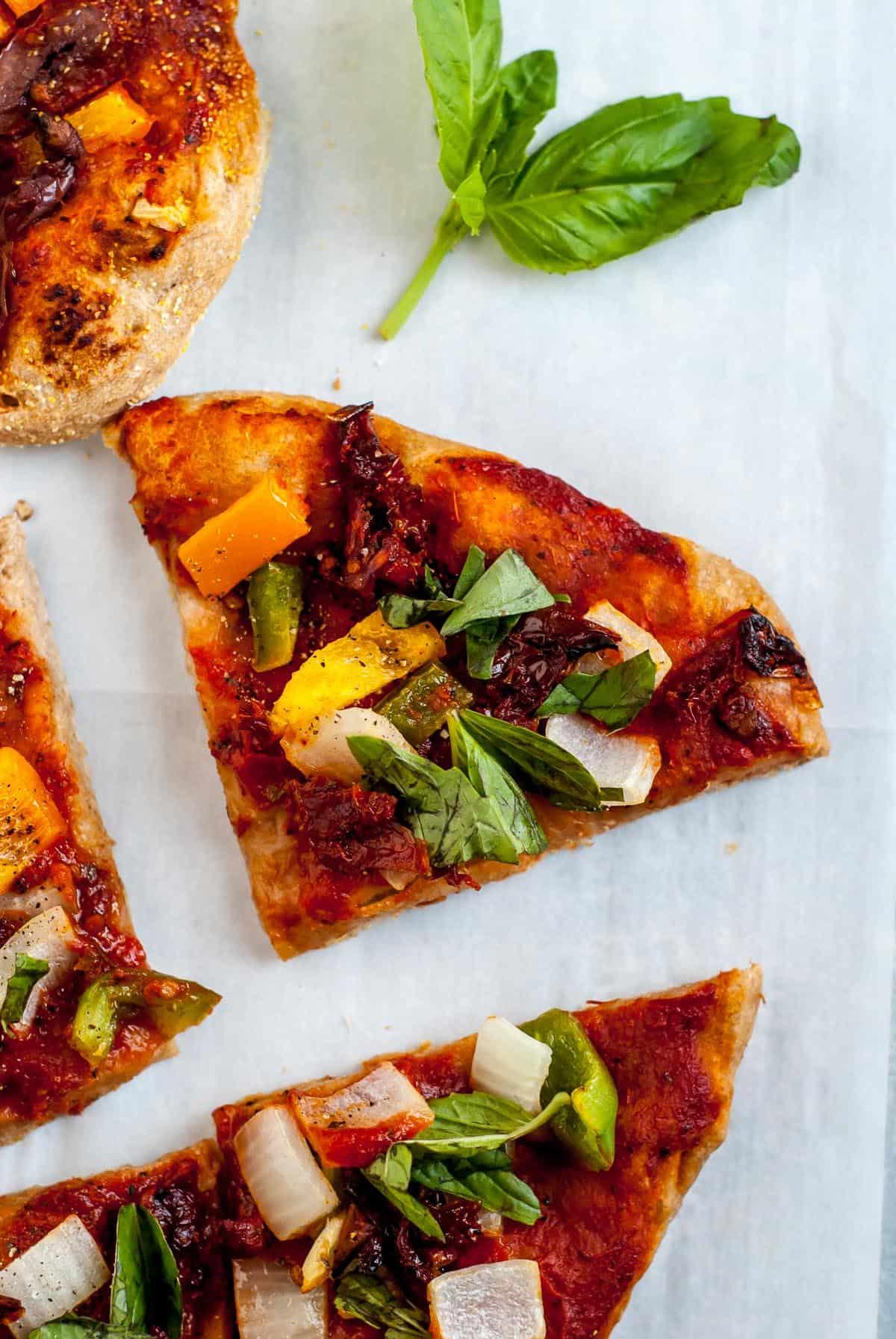 slice of vegan pizza with basil