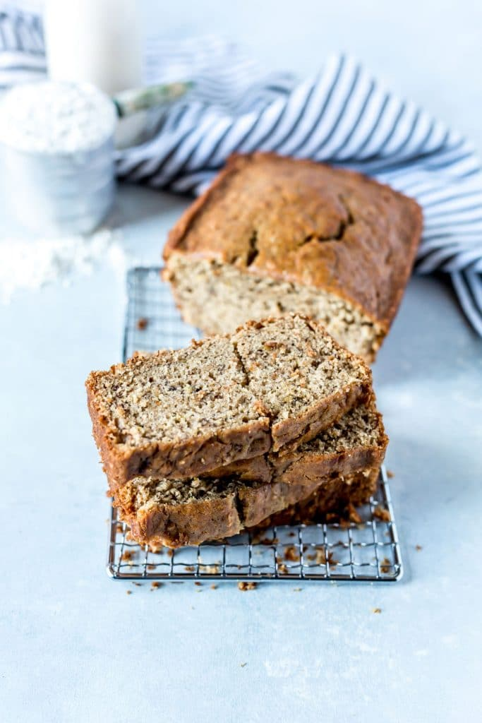 stack of banana bread with slices on a silver grater