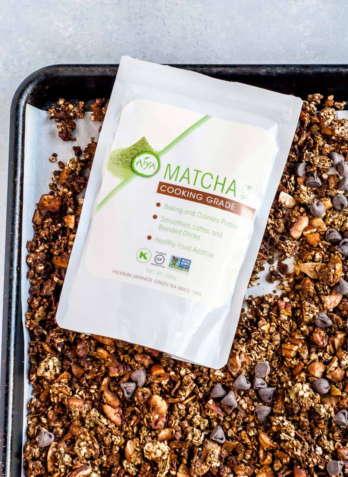 package of matcha on tray of granola