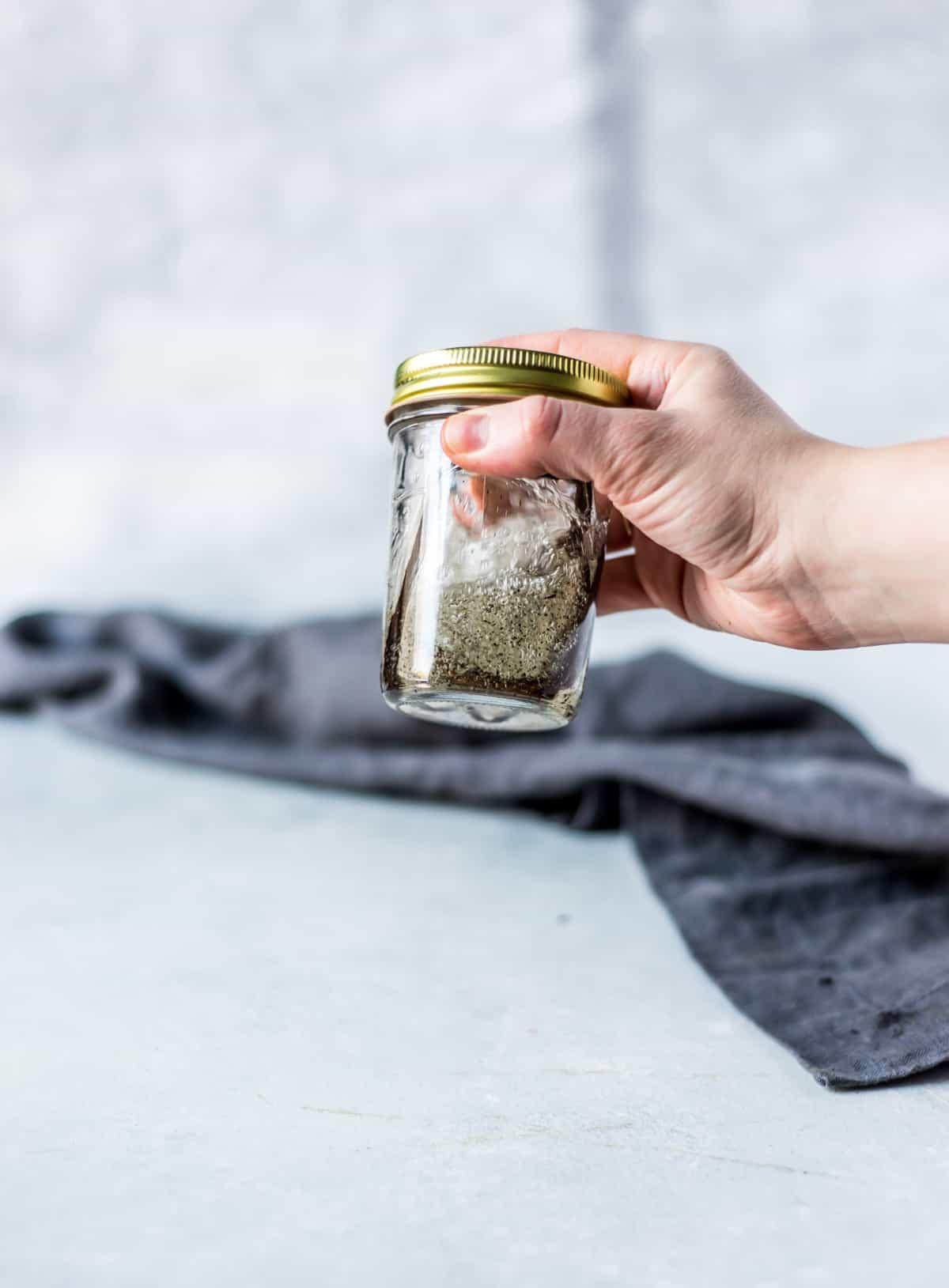 shaking jar of vanilla