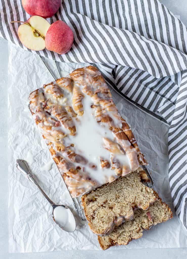 slices and loaf of apple cinnamon babka on white backgound